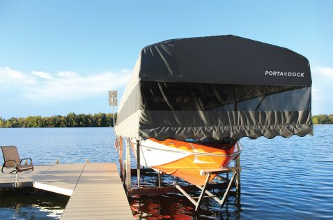 Porta-Dock drop down canopy keeping a boat cool and protected