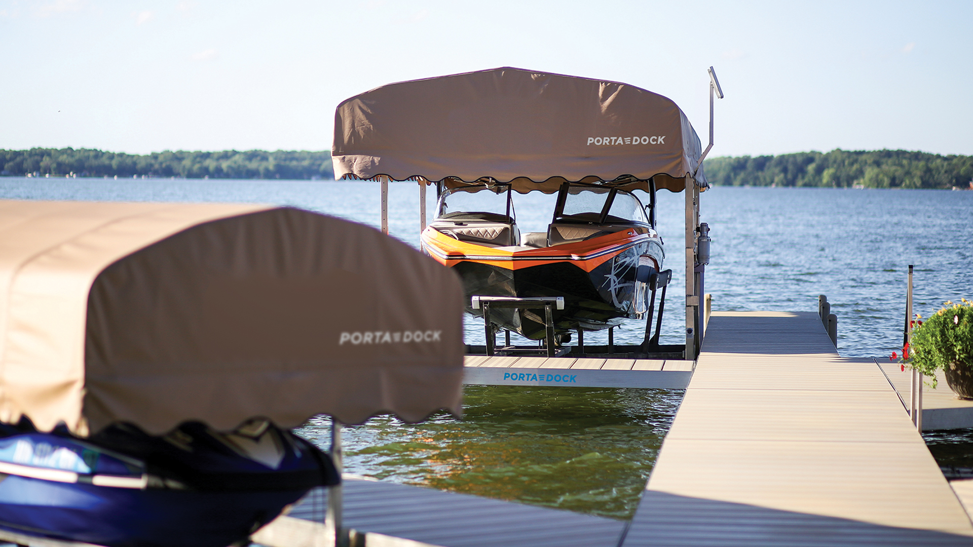 Porta-Dock boat lift on the lake with canopy