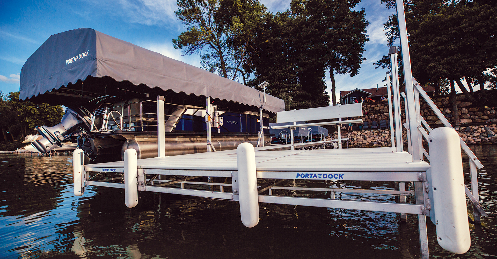 Porta-Dock roll-in dock in the lake with boat lift and canopy