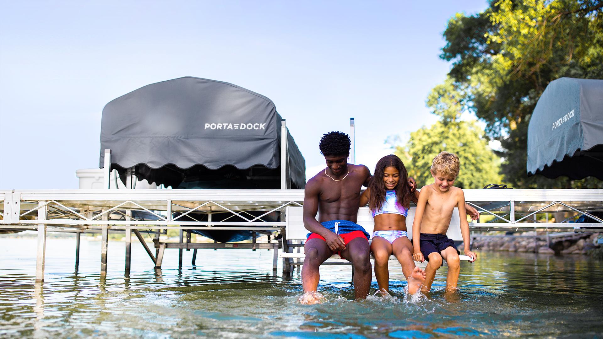 Splashing in the lake on a Porta-Dock swim-up bench
