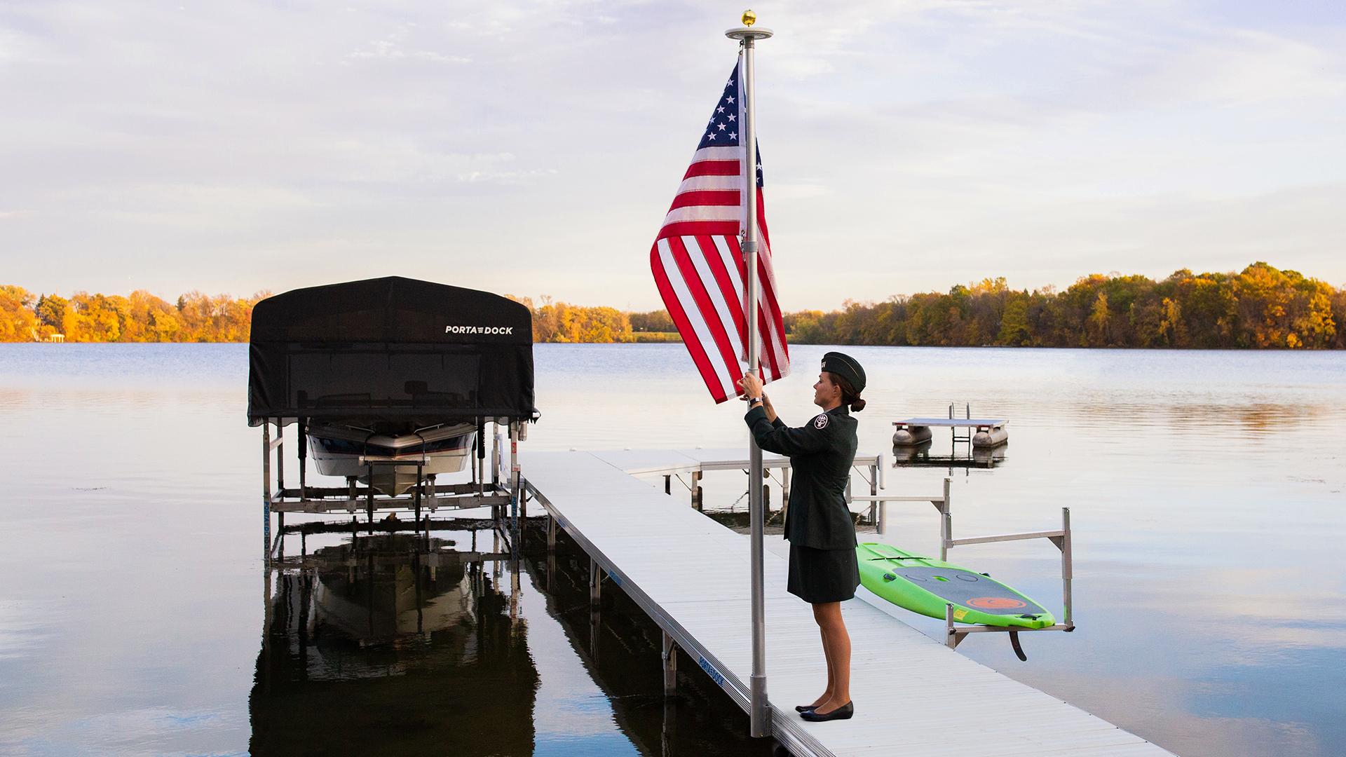 Veteran raising an American flag on a Porta-Dock dock