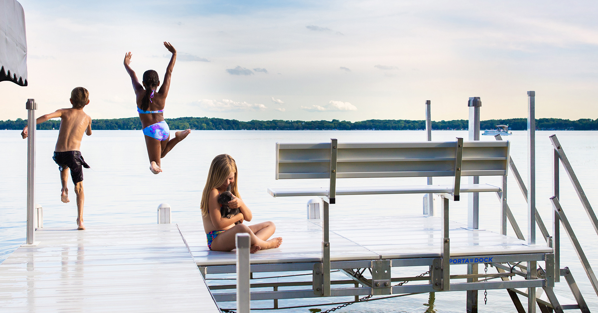 Kids jumping off a Porta-Dock dock into the lake