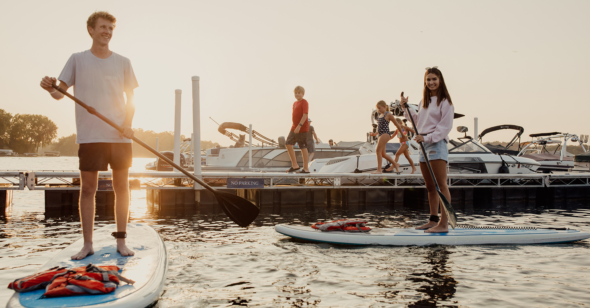 Paddle boarding on the lake by a Porta-Dock dock